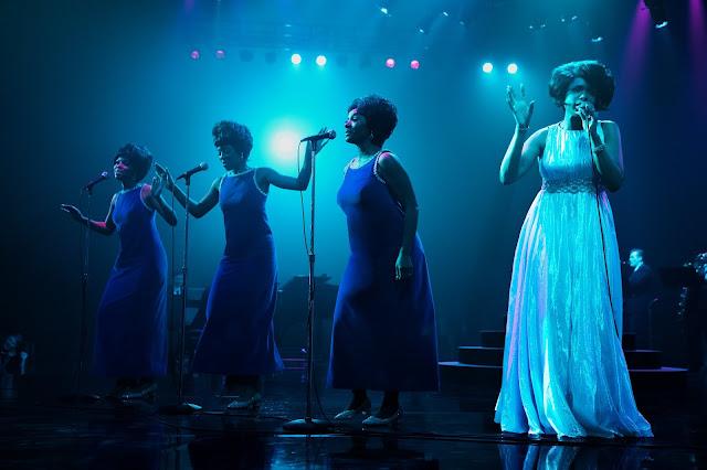 Four ladies sing on stage