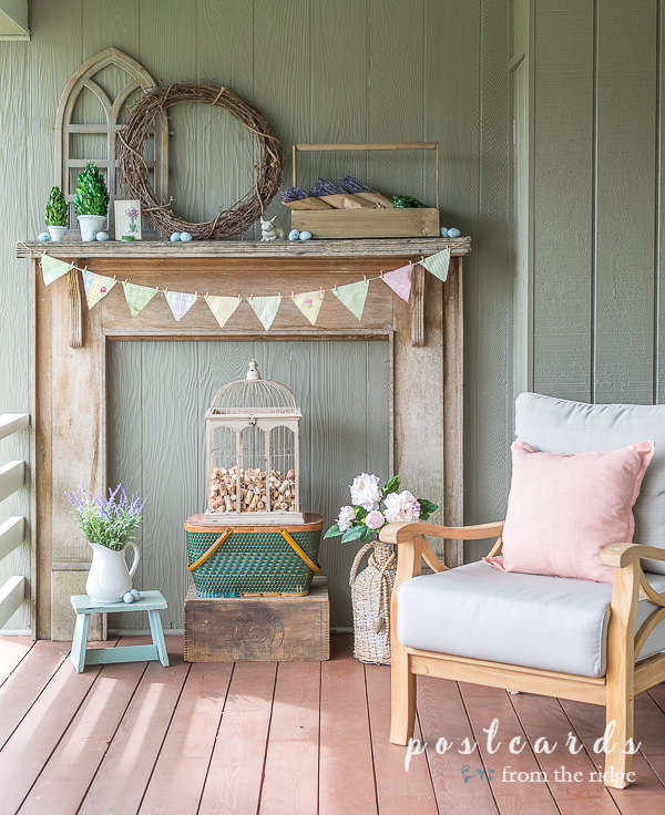 rustic wooden mantel with wooden toolbox and spring decor
