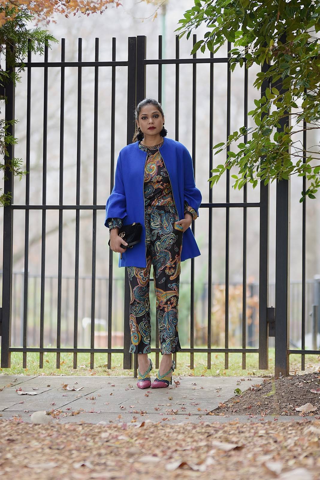 how to wear paisley in winter, pajama wear, coordinates pant and trousers, fashion, street style, blue bell sleevs coat, feather earrings, chevron printed heels, dark lips, gucci marmont bag