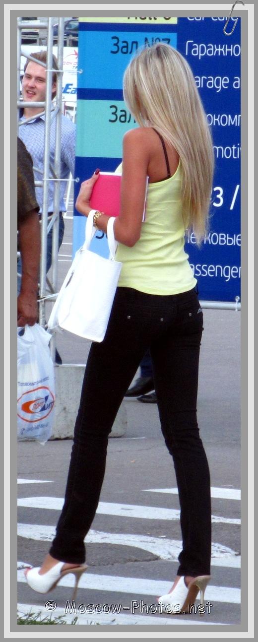 Platinum blonde in black jeans on high heels