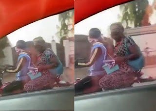 Inside Life: Nigerian mum seen doing her son's assignment on the bike