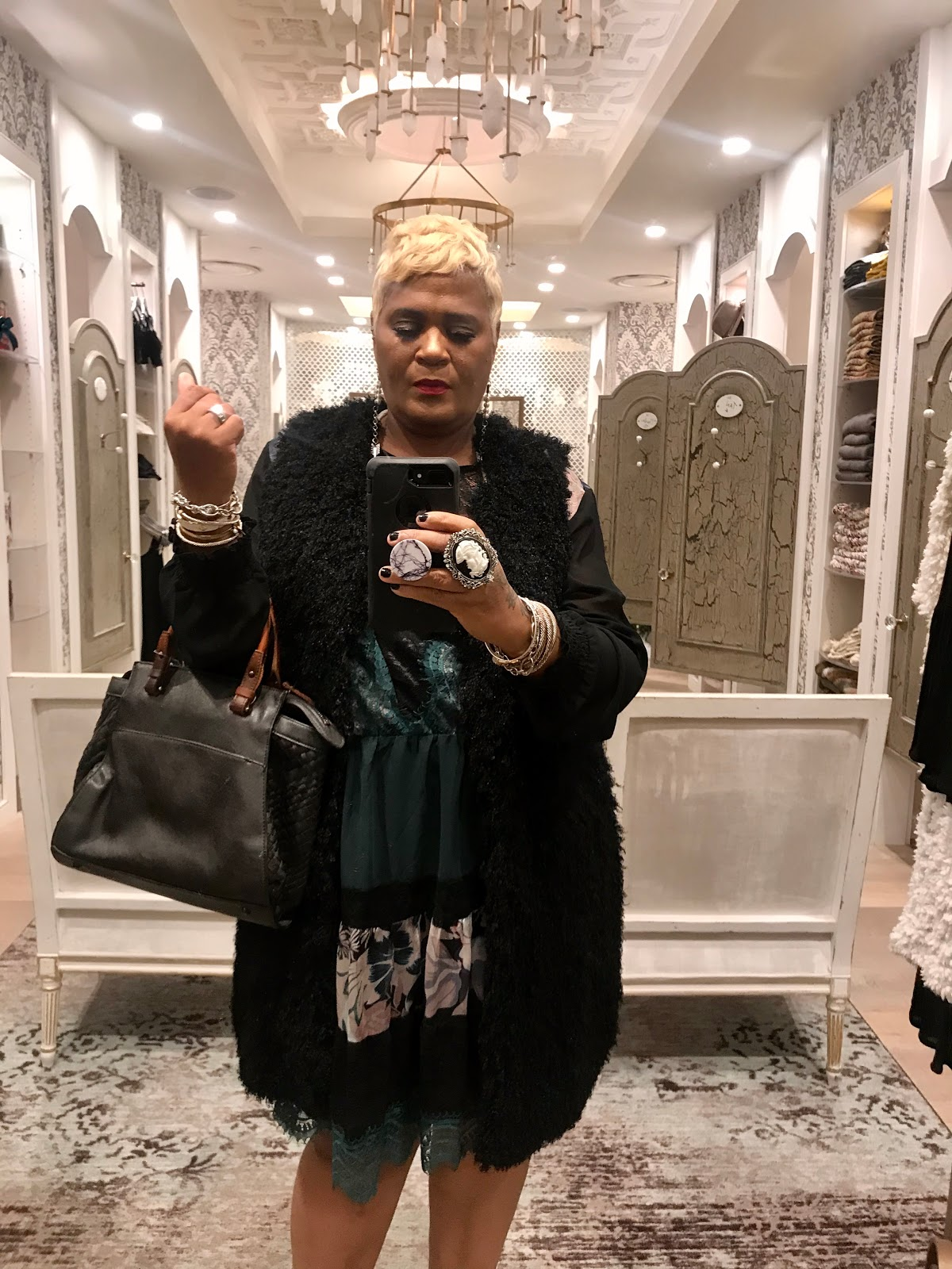 Tangie Bell taking a mirror selfie trying on Rocker chic clothes. Funny Dressing Room Dilemma