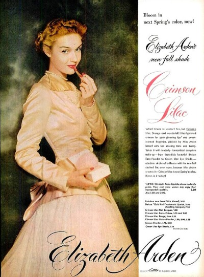 Elizabeth Arden Cosmetic Ad from 1948 for Crimson Lilac Lipstick.. Model is wearing  Antonio Castillo designed gown