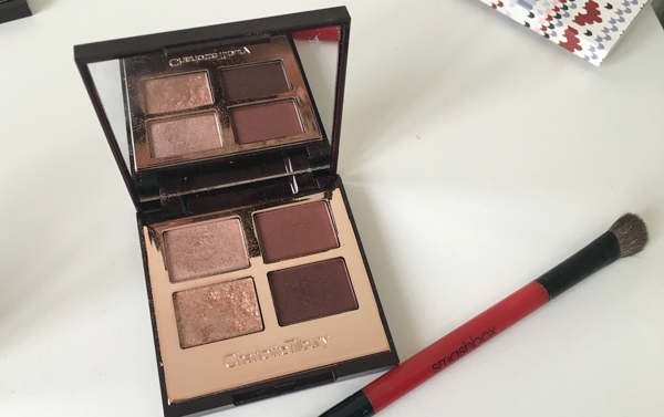 CHARLOTTE TILBURY COLOUR-CODED EYESHADOW in The Vintage Vamp, on a dresser, next to a Smashbox duo eyeshadow brush