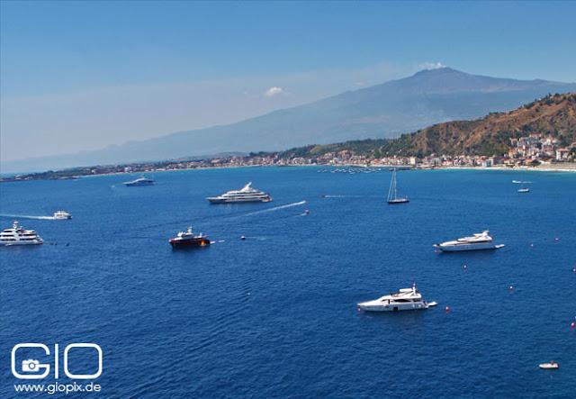 Giardini Naxos Bay with view on volcano Etna