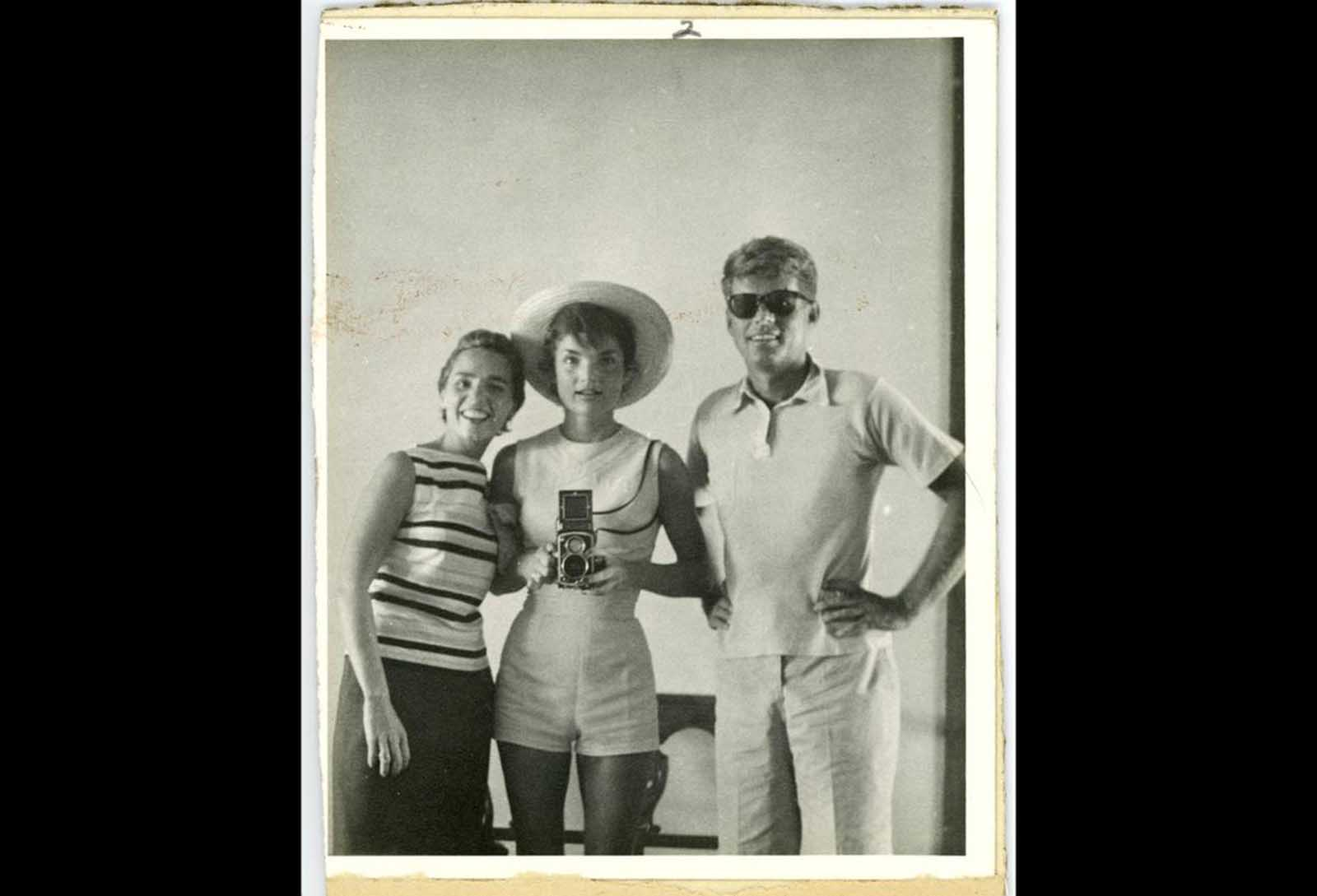 This photo provided by John McInnis Auctioneers in Amesbury, Massachusetts, shows late President John F. Kennedy, right, with his wife, Jacqueline, center, and sister-in-law Ethel Kennedy at left. The photograph is among items that were auctioned on February 17, 2013.
