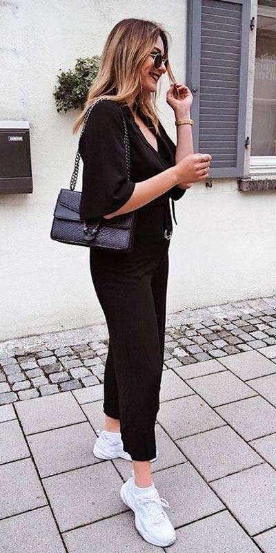 Looking forward to walking your workspace with style? Check out these 24 Stylish Summer Work Outfits for Women that are Office-friendly. Work Wear via higiggle.com | black jumpsuit | #summeroutfits #office #workoutfits #jumpsuit