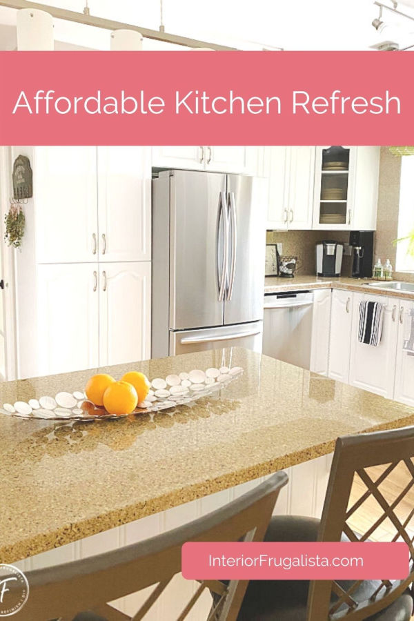 How to give your outdated kitchen a budget-friendly makeover. We repurposed a few things to save money instead of buying new. See the full refresh over on the blog. #kitchenrefresh