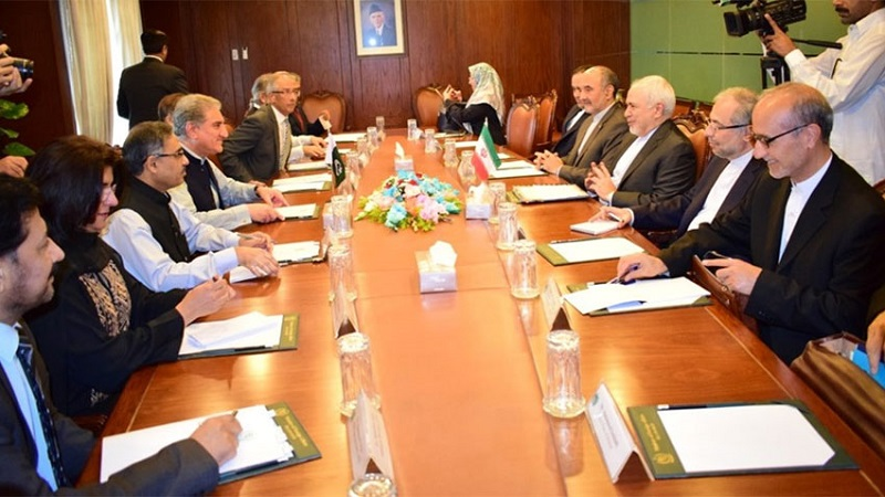 Pakistan Foreign Minister Shah Mehmood Qureshi talks to Iran delegation