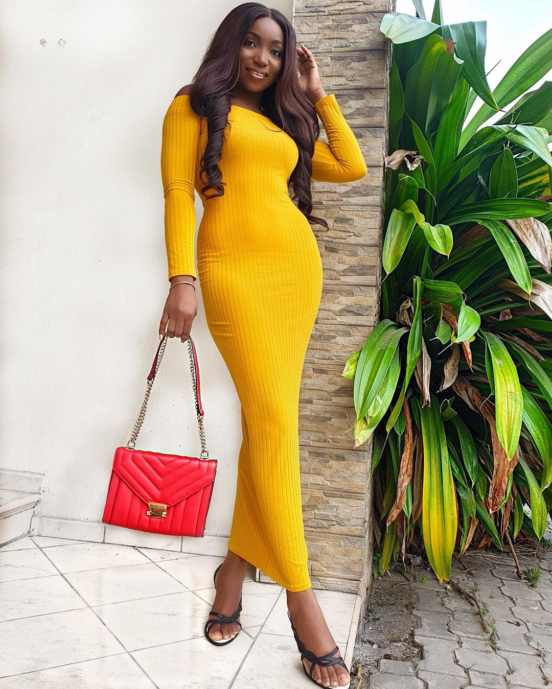 Long fitted yellow long sleeve dress