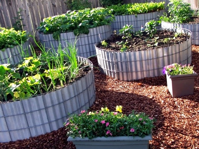 Two Men and a Little Farm ROUND RAISED BEDS INSPIRATION