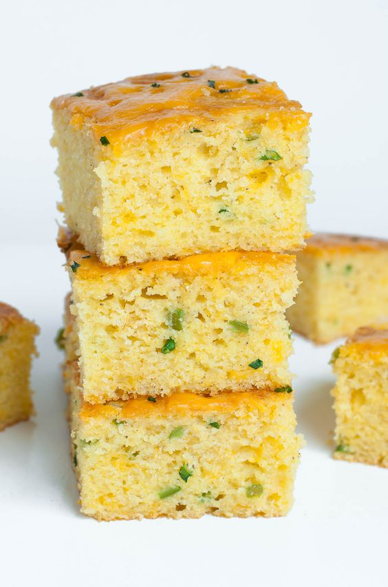 Fantastically fluffy Jalapeño Cheddar Cornbread FTW! This crazy good cornbread gets a leg up from two classic mix-ins: ooey gooey cheddar cheese and fiery jalapeño. The result is a kiss of heat blanketed by cheesy cornbread goodness.