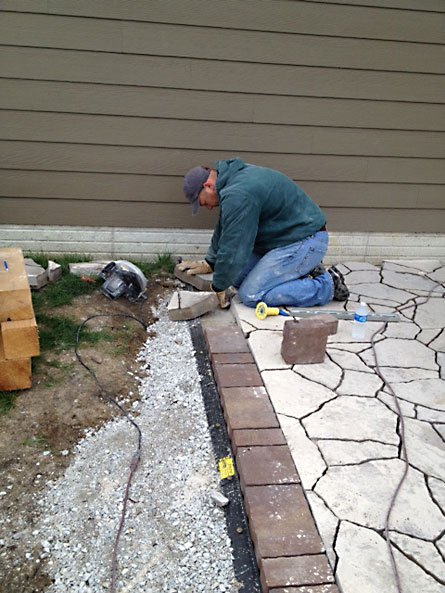 High Quality Josh Measuring And Marking Stone Paver To Cut It.