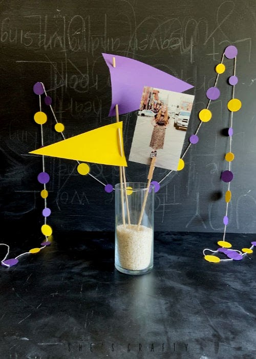Easy and Inexpensive DIY decorations for a Graduation Party - cardstock flags and cardstock circle banner decor