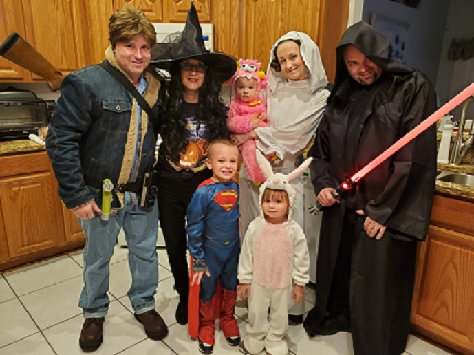 the family dressed for Halloween in costumes