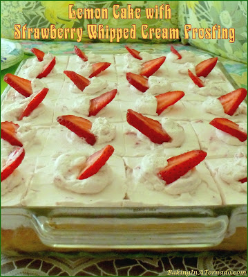 Lemon Cake with Strawberry Whipped Cream Frosting starts with a lemon cake mix with strawberry swirl and topped with fresh strawberry whipped cream. | Recipe developed by www.BakingInATornado.com | #recipe #cake