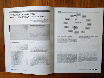 an open magazine spread showing a paper by Kathy Dempsey