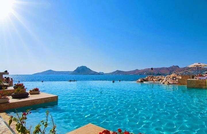 #5. Bodrum, Turkey is a district in the southwestern Aegean Region of Turkey. A photographer commented that the water is so clear the boats seem to be floating mid-air. - 12 Places To Swim With The Clearest, Bluest Waters. #2 Wow!