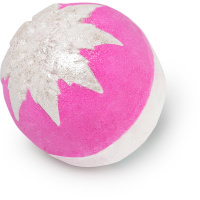 A bright pink spherical bath bomb with a sparkly snowflake made of silver and gold lustre on the side on bright background