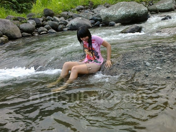 Balinese beautifull girl in the river, not naked