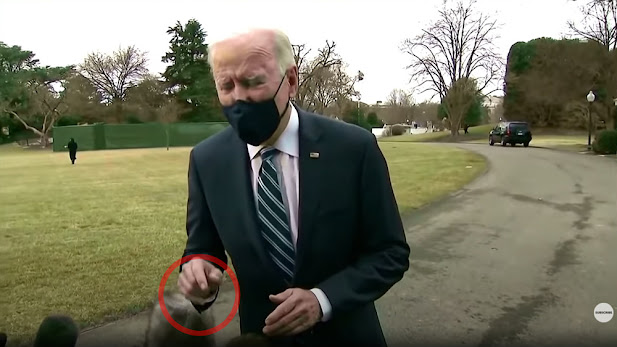FAKE CGI Biden caught moving hand through reporter's camera gear even though his image was standing several feet away