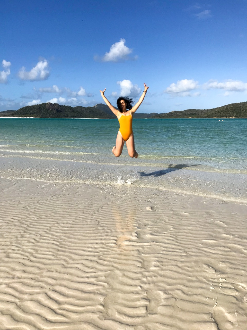 girl jumping on beach in Australia