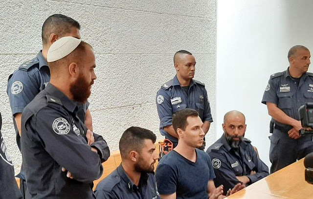 Image Attribute: Aleksey Burkov with Israel Prisons Service personnel at the High Court of Justice in Jerusalem / Dated:  November 3, 2019, Source: Russian Embassy in Israel (Official Facebook Page)