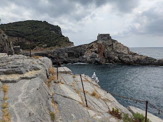 Cliff trails below Castello Doria - looking at the Church of San Pietro and Grotta Byron