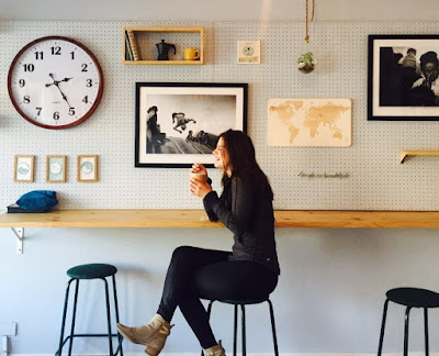 woman sitting at a cafe