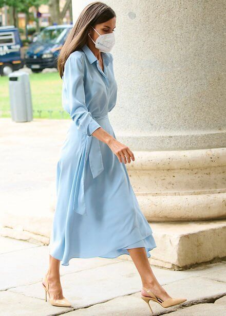 Queen Letizia wore a light blue belted shirt dress from 2019 collection of Pedro del Hierro. Carolina Herrera pumps