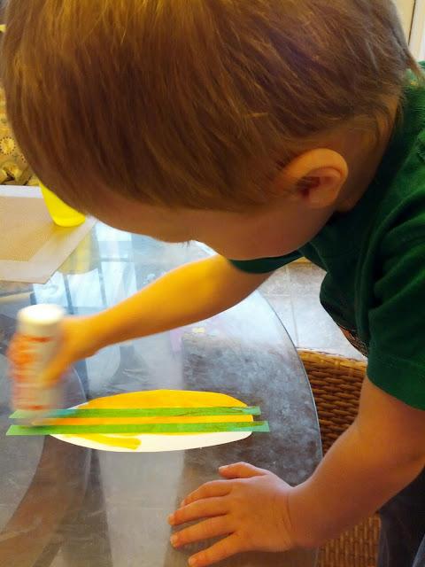 Preschool child doing tape resist art