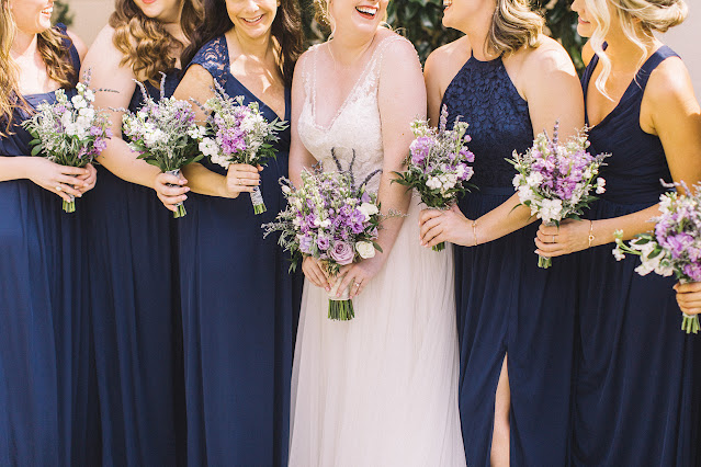 navy bridesmaids dresses and bouquets