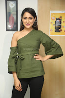 Pragya Jaiswal in a single Sleeves Off Shoulder Green Top Black Leggings promoting JJN Movie at Radio City 10.08.2017 081.JPG