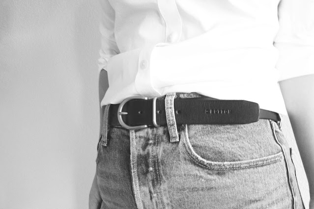 Black and white picture of woman wearing a black leather belt from Botton Studio