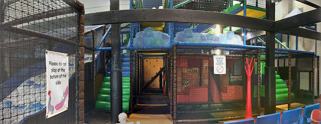 Panoramic view of the soft play area for 4 to 10 year olds showing the slide and steps up