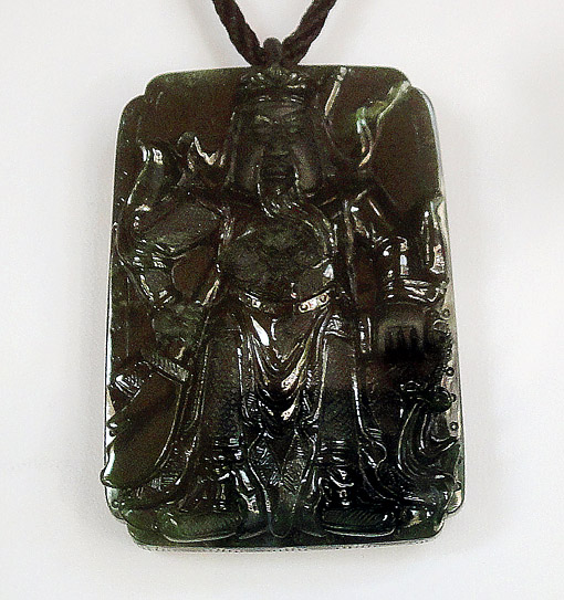 black jade pendant with carved warrior