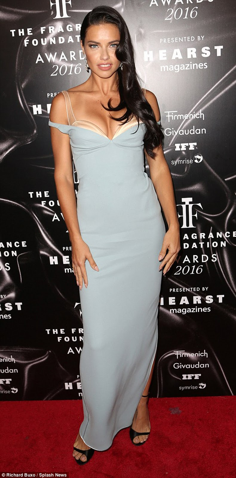 MODEL ADRIANA LIMA - Adriana Lima was smoking hot in powder blue Marc Jacobs as she arrived at the Fragrance Foundation Awards in New York City on Tuesday evening