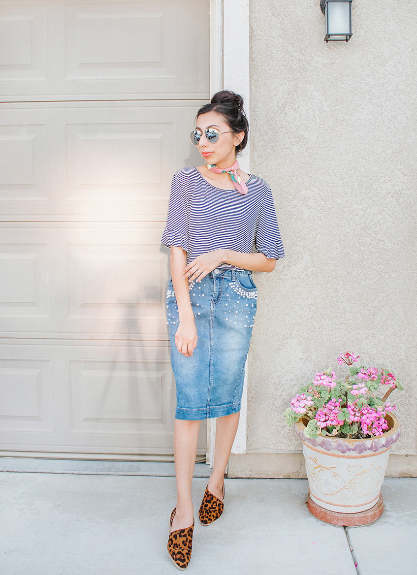 61a99a5afa I paired my new denim skirt with feminine prints and details.