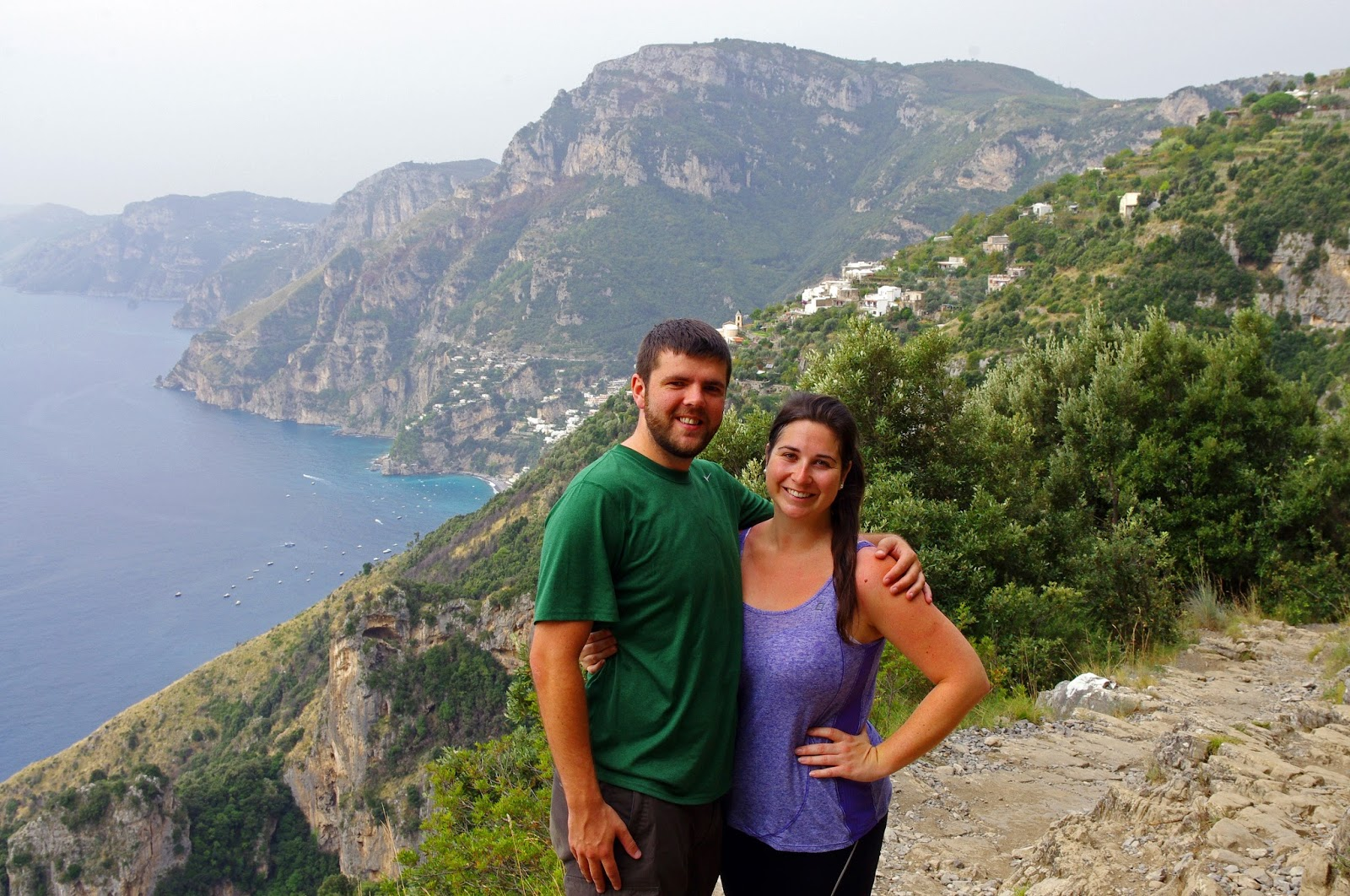 Couple hiking Path of the Gods in Italy