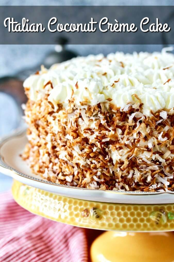 Italian Coconut Crème Cake finished with toasted coconut and piped cream