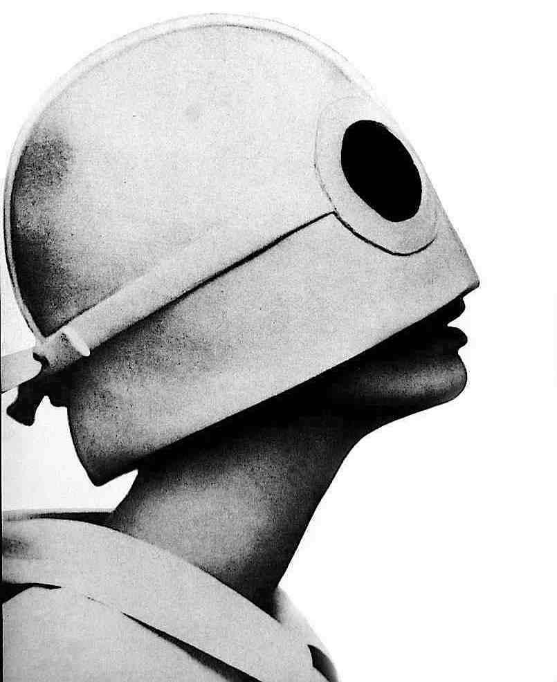 a 1965 Bert Stern photograph of a mod model in profile with odd head wear