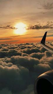 خلفيات جناح طيارة مع شروق الشمس
