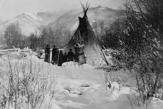 Kalispel Indian people outside their teepee with tons of snow all around. Image credit to Yolanda Bowman of the tribe.