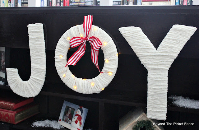 Joy sign, lighted sign, yarn, Christmas decor, http://www.beyondthepicket-fence.com/2016/12/12-days-of-christmas-day-11-warm-and.html