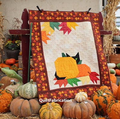 pumpkin and black cat wall hanging set in a pumpkin patch by QuiltFabrication