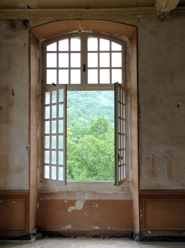 French windows open in a decaying room of Chateau Gudanes. Weathered Walls & Déshabillé Lovely. #walls #distressed #chateaugudanes #windows #oldworld