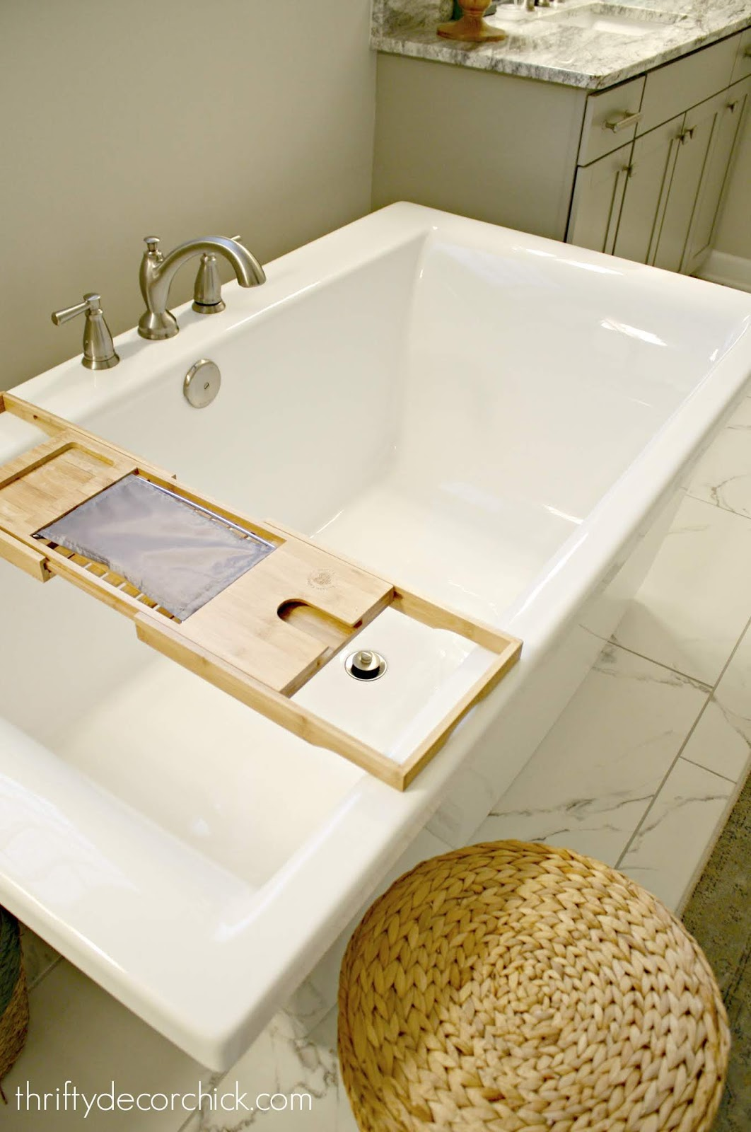 Deep soaking tub with wood caddy