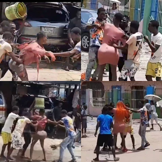 Watch the Moment a Crossdresser was beaten mercilessly by Area Boys in Lagos (Videos)