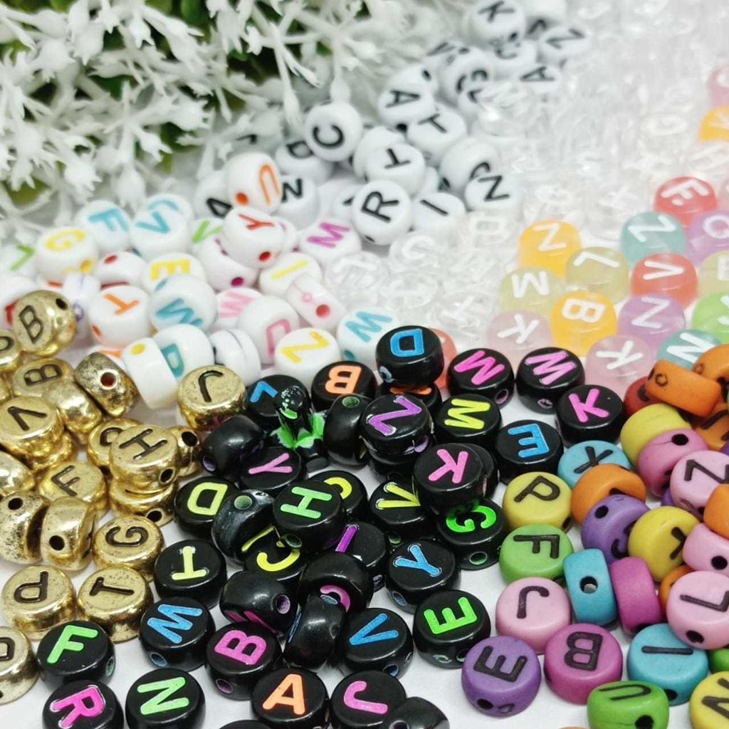 Letrinhas multi coloridas e douradas