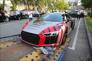 Xe Audi R8 của doanh nhân Quốc Cường được dán decal có chi phí lên đến vài trăm triệu đồng